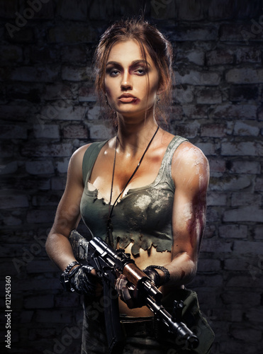 Fotografie, Obraz  Beautiful girl with a gun in his hand
