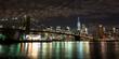 Brooklyn Bridge in front of Manhattan at night