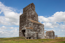 Old Weathered Grain Elevator With Blue Sky And Clouds