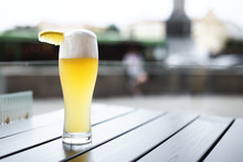 Wheat Beer With Slice Of Lemon On Table