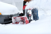 Snow Blower Clearing Snow From...
