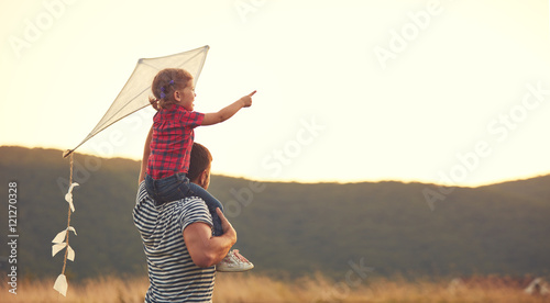 happy family father and child on meadow with a kite in summer Wallpaper Mural