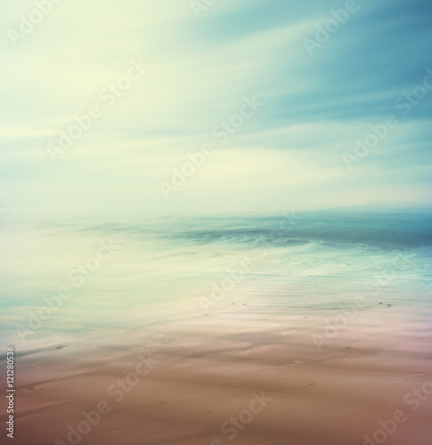 Cross-Processed Sea and Sand. An abstract, time-exposure seascape with panning movement.  Image displays a retro, vintage look with cross-processed colors. Fotomurais