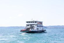 Ferry Boat Transporting Cars On A Lake Lago Di Garda