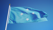 Federated States Of Micronesia Flag Waving Against Clean Blue Sky, Close Up, Isolated With Clipping Path Mask Alpha Channel Transparency
