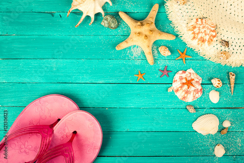 Papiers peints Retro Summer accessories on blue wooden background.