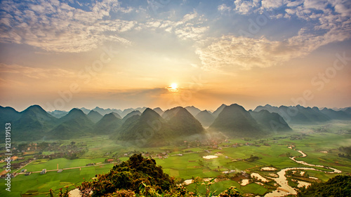 Tuinposter Zwavel geel Sunrise Colorful rice field in valley around with mountain panor