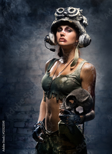 Fotografie, Obraz  Portrait of sexy girls - a soldier with a skull trophy in hands
