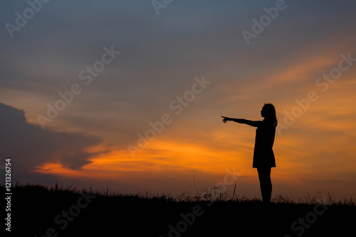 Garden Poster Martial arts ilhouette young woman pointing forward to Dream ahead in sunset