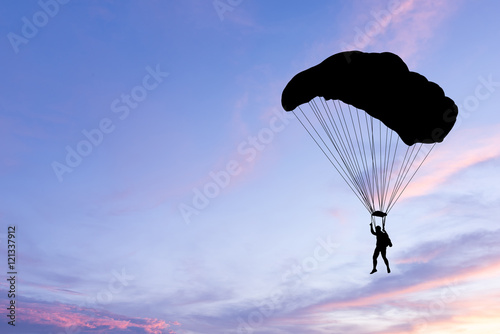 Foto op Canvas Luchtsport Silhouette of parachute on sunset background