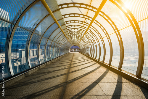 Photo Stands Tunnel Empty tunnel with footpath lit by sunset