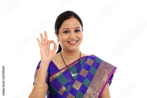 Valokuva  Traditional Indian Young woman making OK sign