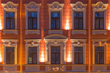 Several Windows In A Row On Night Illuminated Facade Of Urban Office Building Front View, St. Petersburg, Russia.