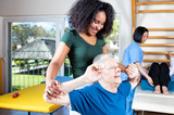 Elder retired man assisted by nurse in rehab clinic - 121383338