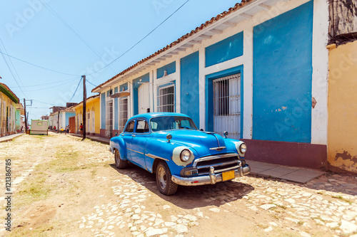 Vintage blue car near Houses in the old town, Trinidad Canvas Print