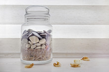 Jar With Sand And Rocks From T...
