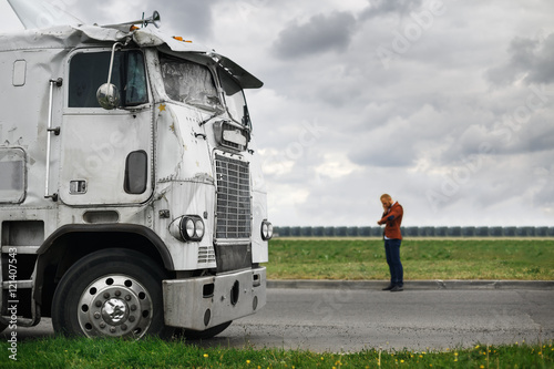 broken truck after the accident in foreground