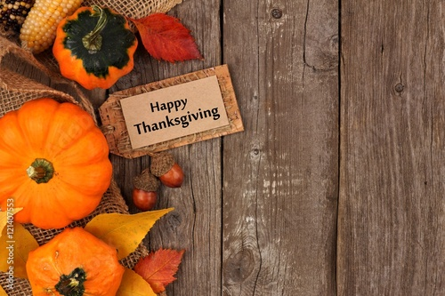 Happy Thanksgiving Gift Tag With Side Border Of Colorful Leaves And Pumpkins Over A Rustic Wood