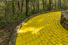 Winding Yellow Brick Road With Stone Edges And A Shallow Depth Of Field