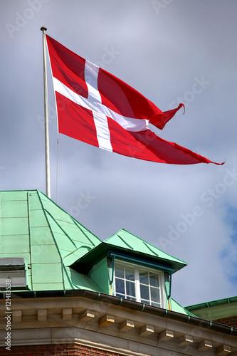 Photo  Waving Danish flag on the mast in Copenhagen, Denmark