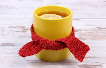 Cup Of Hot Tea With Lemon Wrapped Woolen Scarf, Warming Beverage For Flu And Cold