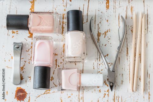Staande foto Manicure Selection of manicure tools on white wood background