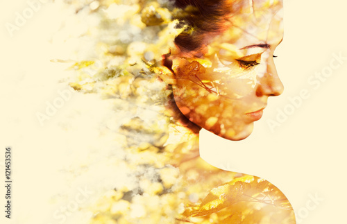 Foto  Double exposure portrait of young woman and autumn falling leave