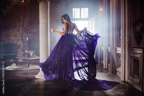 Canvas Print Beauty Brunette model woman in evening purple dress