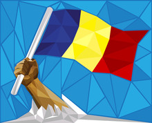 Strong Hand Raising Up The Romanian Flag