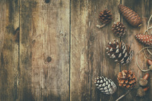 Top View Of Pine Cones On Rustic Wooden Background