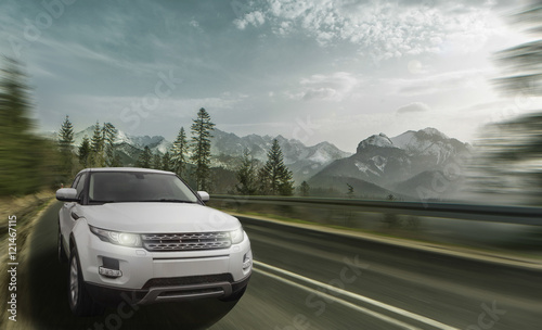 Obraz High speed driving car on a mountain road - fototapety do salonu