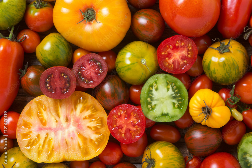 Fototapety, obrazy: Close up of colorful tomatoes, some sliced, shot from above