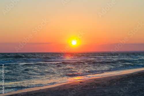 Foto op Aluminium Strand Beautiful sunset over the Black Sea in the summer.The bird flying over water. Sea landscape. Nature composition