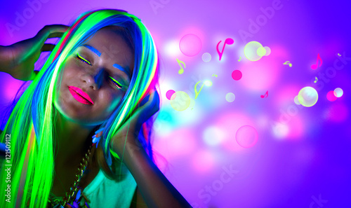 Beautiful young woman in neon light Poster Mural XXL