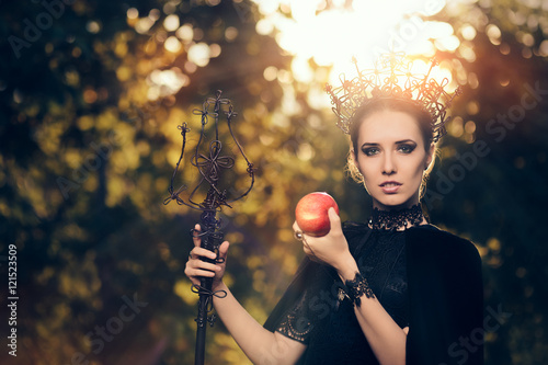 Fotografie, Obraz  Evil Queen with Poisoned  Apple in Fantasy Portrait