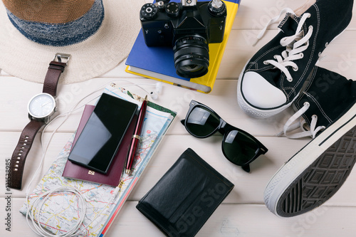 Fotografia  travelers vacation items on white wooden table