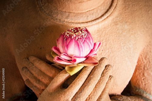 Lotus in the hands of sandstone Buddha. Fototapete
