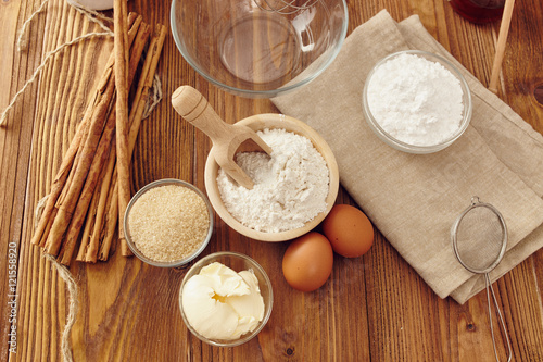 Printed kitchen splashbacks Dairy products Ingredients to make a cake or a dessert on an aged wooden table