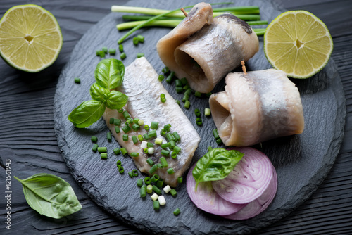 Fotografie, Obraz  Close-up of a stone slate with herring fillet, studio shot