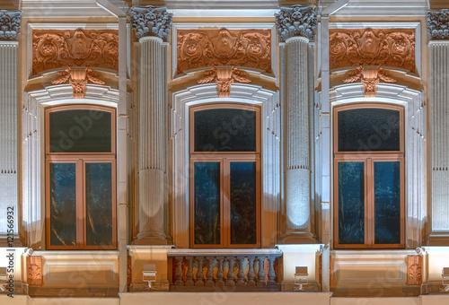 Three Windows In A Row And Balcony On Night Illuminated