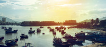 Fishing Boats Returning To Port At Sunset, Vietnam.