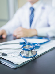 Medicine doctor's working table. Focus on stethoscope