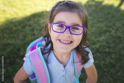 Fotografie, Obraz  A girl wearing a uniform and a backpack is ready for her first day of school