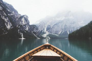 Naklejka Wood boat in Braies lake