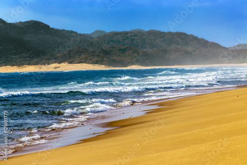 Foto op Canvas Zuid Afrika South Africa, KwaZulu-Natal province. iSimangaliso Wetland Park (Greater St. Lucia Wetlands Park, on UNESCO World Heritage Site) - sandy beach near St. Lucia town. Waves blur motion effect