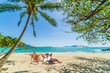 Couple on the beach at tropical resort Travel magazine