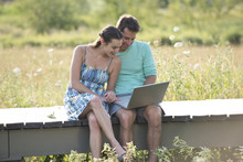 Couple Sitting On Countryside ...