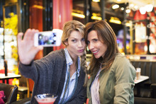 Women In Bar Taking Self-portr...