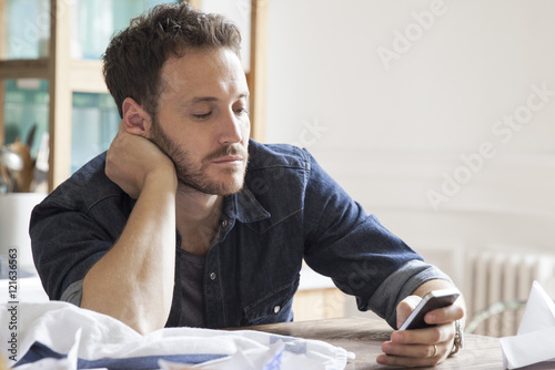 Man at home using smartphone Poster