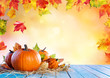 canvas print picture Thanksgiving Background - Pumpkins On Wooden Plank And Falling Leaves